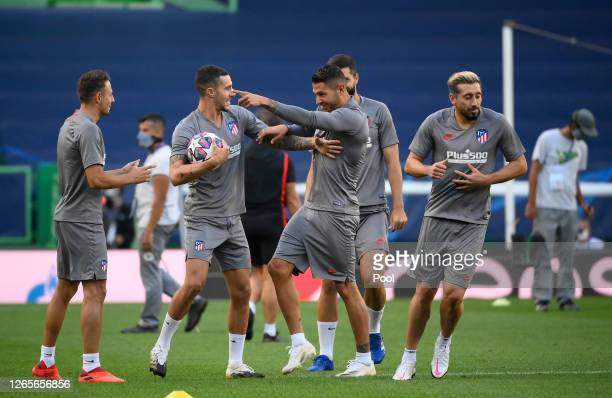 Mario Hermoso of Atletico Madrid trains with Vitolo of Atletico Madrid during a training session ahead of their UEFA Champions League quarter-finals...