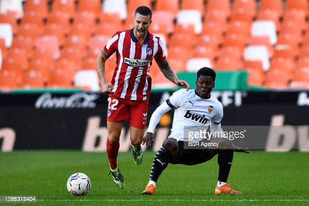 Mario Hermoso of Atletico Madrid, Yunus Musah of Valencia CF before the La Liga Santander match between Valencia CF and Atletico Madrid at Mestalla...