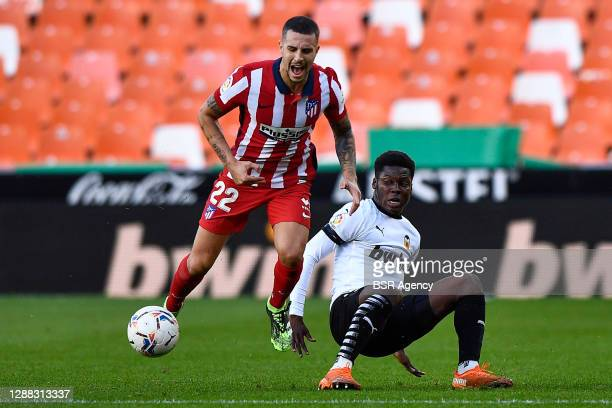 Mario Hermoso of Atletico Madrid, Yunus Musah of Valencia CF during the La Liga Santander match between Valencia CF and Atletico Madrid at Mestalla...
