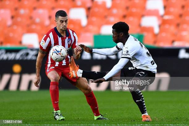 Mario Hermoso of Atletico Madrid, Yunus Musah of Valencia CF in action during the La Liga Santander match between Valencia CF and Atletico Madrid at...