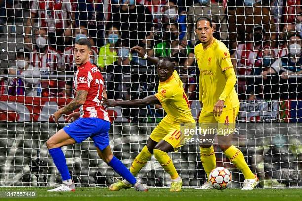 Mario Hermoso of Club Atletico de Madrid, Sadio Mane of Liverpool FC and Virgil van Dijk of Liverpool FC during the Group B - UEFA Champions League...