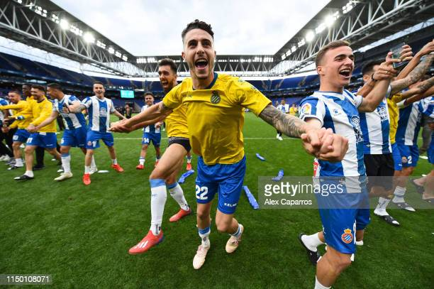 Mario Hermoso of RCD Espanyol celebrates with his team mates winning a UEF Europa League position next season at the end of the La Liga match between...