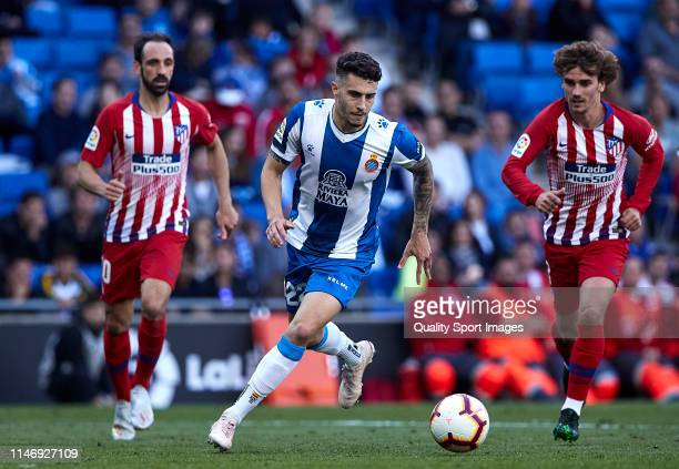 Mario Hermoso of RCD Espanyol competes for the ball with Juanfran Torres and Antoine Griezmann of Club Atletico de Madrid during the La Liga match...
