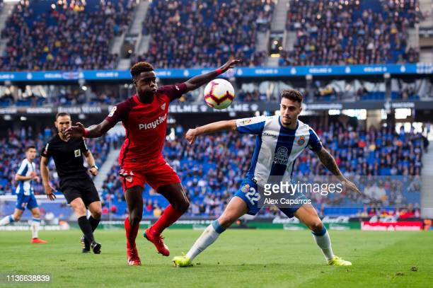 Mario Hermoso of RCD Espanyol competes for the ball with Quincy Promes of Sevilla FC during the La Liga match between RCD Espanyol and Sevilla FC at...