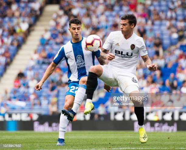 Mario Hermoso of RCD Espanyol competes for the ball with Santi Mina of Valencia CF during the La Liga match between RCD Espanyol and Valencia CF at...