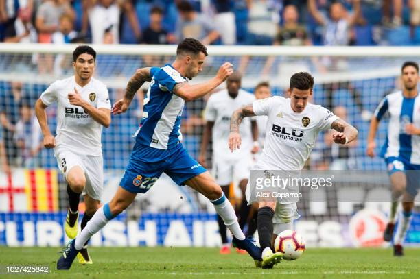 Mario Hermoso of RCD Espanyol fights for the ball with Santi Mina of Valencia CF during the La Liga match between RCD Espanyol and Valencia CF at...