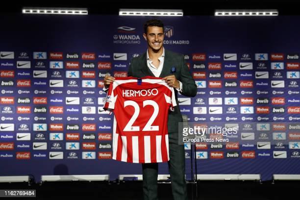 Mario Hermoso poses with his tshirt during his presentation as a new football player of Atletico de Madrid at Estadio Wanda Metropolitano on July 18...