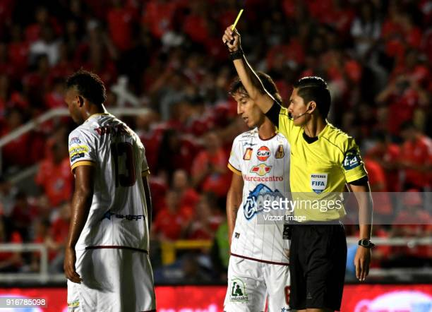 Mario Herrera referee shows the yellow card to Nilson Castrillon of Deportes Tolima during a match between America de Cali and Deportes Tolima as...