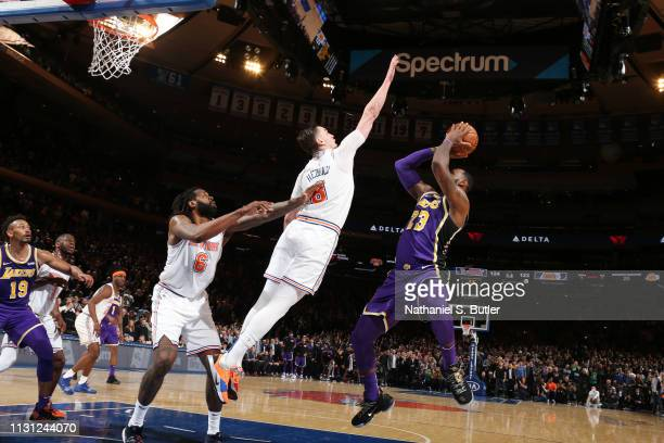 Mario Hezonja of the New York Knicks blocks the shot against LeBron James of the Los Angeles Lakers during the game on March 17 2019 at Madison...