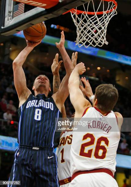 Mario Hezonja of the Orlando Magic lays one in against Kyle Korver of the Cleveland Cavaliers at Quicken Loans Arena on January 18 2018 in Cleveland...