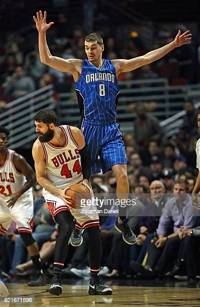 Mario Hezonja of the Orlando Magic leaps to try and block Nikola Mirotic of the Chicago Bulls at the United Center on November 7 2016 in Chicago...