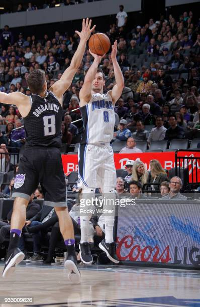 Mario Hezonja of the Orlando Magic shoots a three pointer against Bogdan Bogdanovic of the Sacramento Kings on March 9 2018 at Golden 1 Center in...