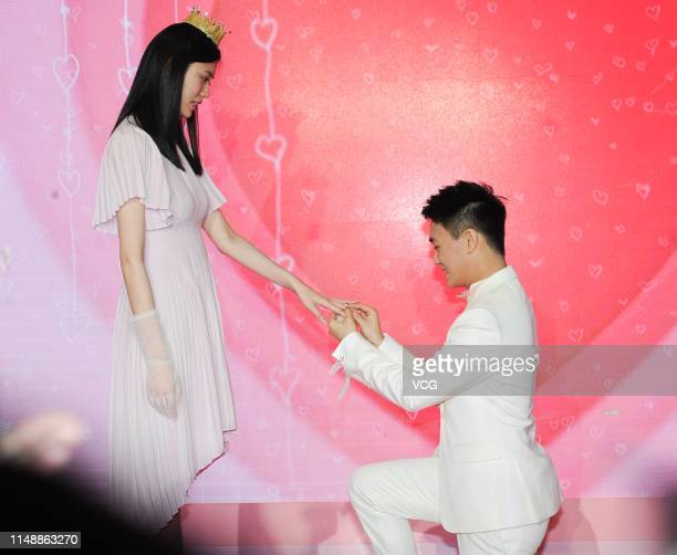 Mario Ho Yaukwan son of SJM Holdings founder Stanley Ho proposes to model Ming Xi Mengyao at L' Avenue Shanghai on May 13 2019 in Shanghai China