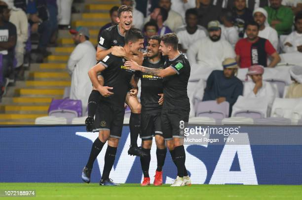 Mario Ilich of Team Wellington celebrates after scoring his team's third goal with team mates during the FIFA Club World Cup first round play-off...