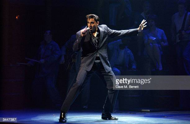 Mario Kambou performs on stage during the London premiere and press night of Jailhouse Rock at the Piccadilly Theatre on April 19 2004 in London The...