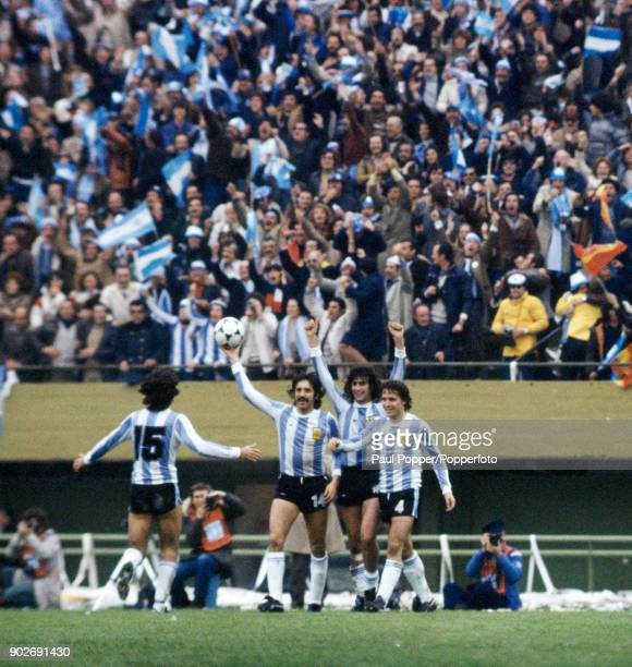 Mario Kempes has scored Argentina's 2nd goal and celebrates with Leopoldo Luque and Daniel Bertoni as Jorge Olguin runs to join them during the FIFA...