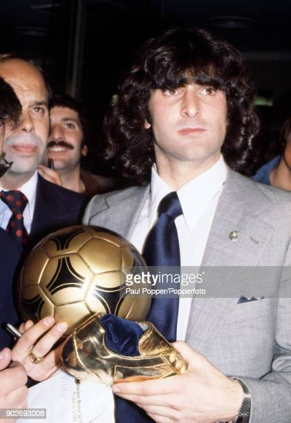 Mario Kempes of Argentina with the Adidas golden ball and golden boot awards for being chosen as the Player of the Tournament at the FIFA World Cup...