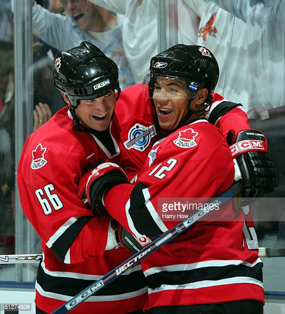 Mario Lemieux and Jarome Iginla of Team Canada celebrate a goal by teammate Joe Sakic against Team Slovakia for a 40 Canada lead during the second...