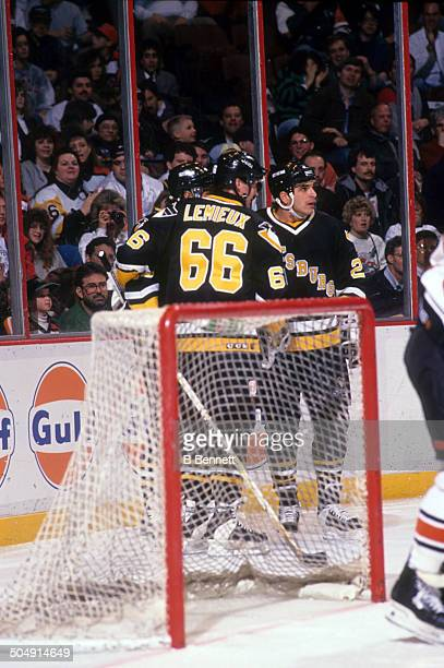 Mario Lemieux and Kevin Stevens of the Pittsburgh Penguins celebrate a goal during the game against the Philadelphia Flyers on March 2 1993 at the...