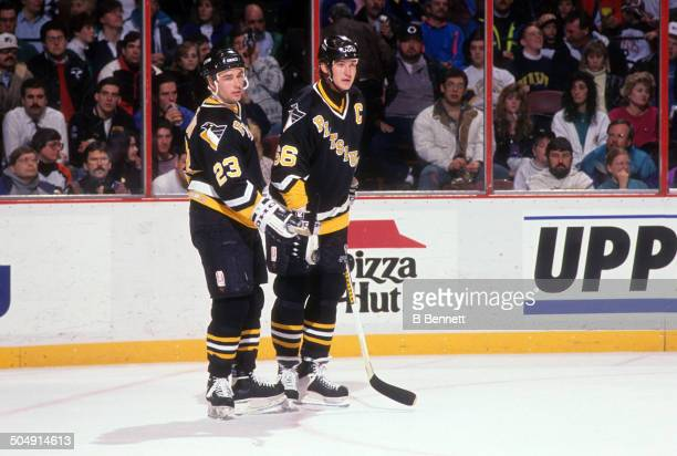 Mario Lemieux and Paul Stanton of the Pittsburgh Penguins skate on the ice during the game against the Philadelphia Flyers on March 2, 1993 at the...