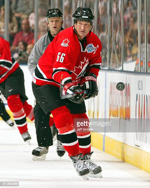 Mario Lemieux of Team Canada flips the puck into the Team Russia end during the third period in the World Cup of Hockey on September 4, 2004 at the...