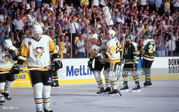 Mario Lemieux of the Pittsburgh Penguins celebrates a goal with teammate Kevin Stevens during Game 2 of the 1991 Stanley Cup Finals against the...