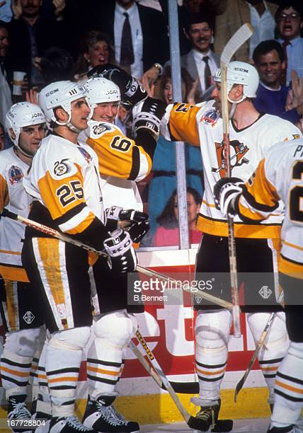 Mario Lemieux of the Pittsburgh Penguins celebrates with teammates Kjell Samuelsson Kevin Stevens and Rick Tocchet during Game 1 of the 1992 Stanley...