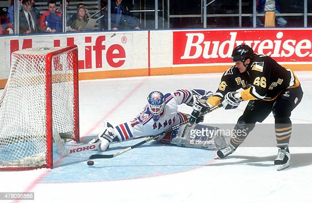Mario Lemieux of the Pittsburgh Penguins is stopped by Corey Hirsch of the New York Rangers on January 1, 1980 at Madison Square Garden in New York,...