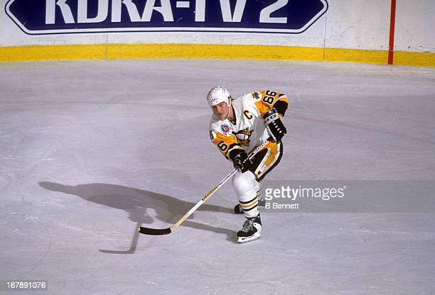 Mario Lemieux of the Pittsburgh Penguins passes the puck during Game 1 of the 1992 Stanley Cup Finals against the Chicago Blackhawks on May 26, 1992...
