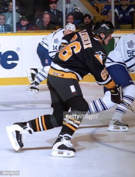 Mario Lemieux of the Pittsburgh Penguins skates against the Toronto Maple Leafs during NHL game action on February 12 1996 at Maple Leaf Gardens in...