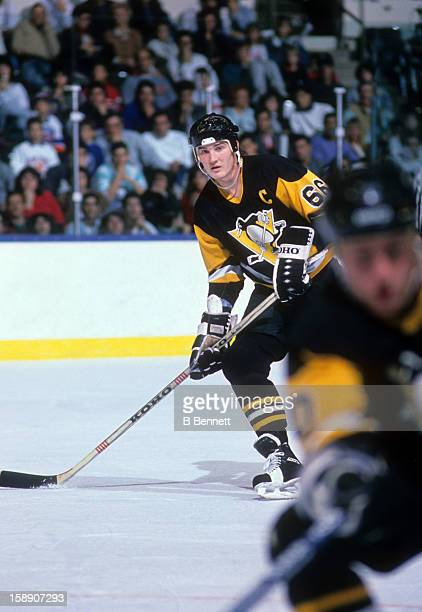 Mario Lemieux of the Pittsburgh Penguins skates on the ice during an NHL game against the New York Islanders on November 19 1988 at the Nassau...
