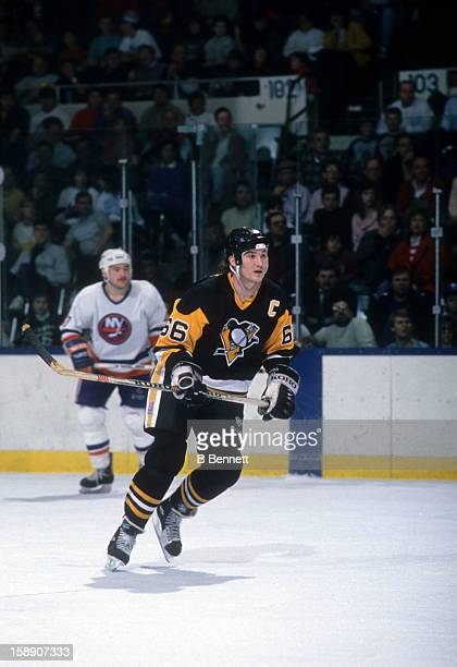 Mario Lemieux of the Pittsburgh Penguins skates on the ice during an NHL game against the New York Islanders on February 25, 1989 at the Nassau...