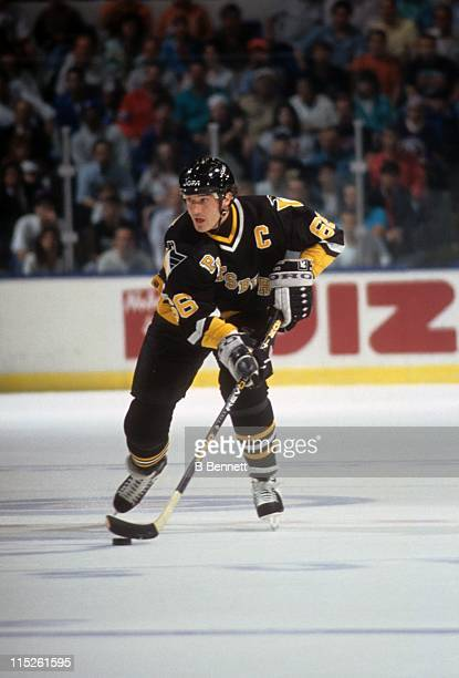 Mario Lemieux of the Pittsburgh Penguins skates with the puck during an NHL game circa 1993.