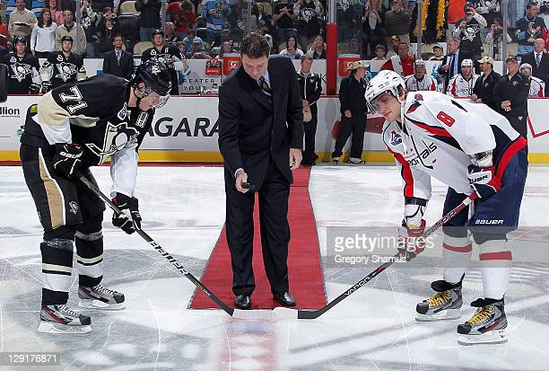 Mario Lemieux owner of the Pittsburgh Penguins drops a ceremonial puck to Evgeni Malkin of the Penguins and Alex Ovechkin of the Washington Capitals...