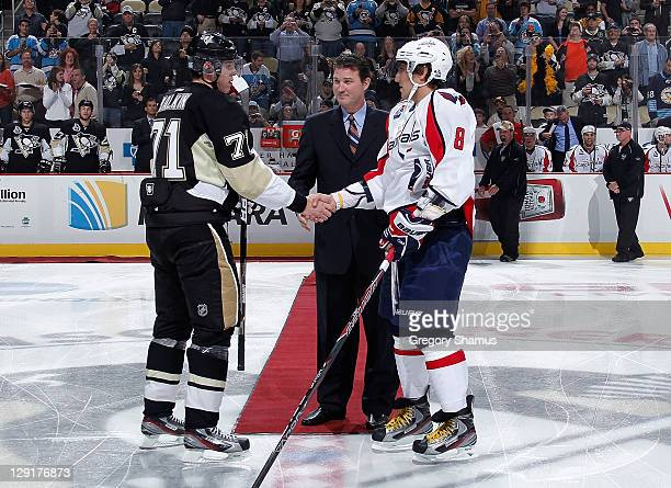 Mario Lemieux owner of the Pittsburgh Penguins shakes hands with Evgeni Malkin of the Penguins and Alex Ovechkin of the Washington Capitals prior to...