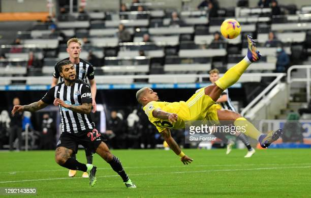 Mario Lemina of Fulham clears the ball acrobatically as DeAndre Yedlin of Newcastle United looks on during the Premier League match between Newcastle...