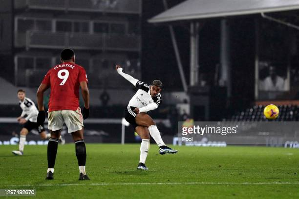 Mario Lemina of Fulham takes a shot as Anthony Martial of Manchester United looks on during the Premier League match between Fulham and Manchester...