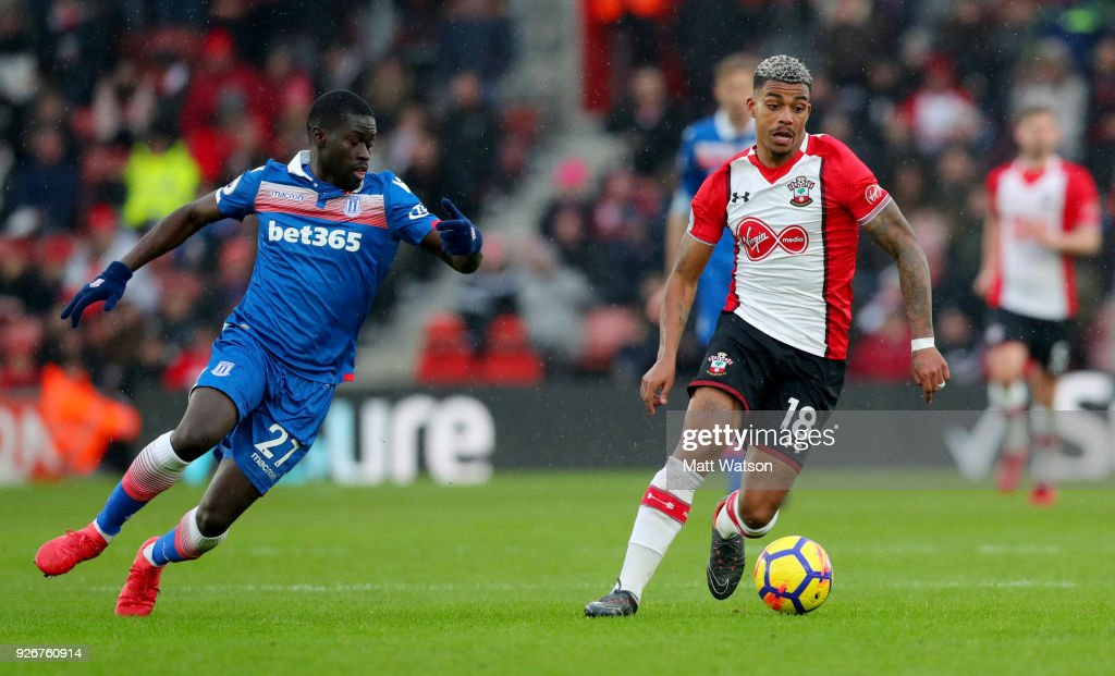 Mario Lemina (R) of Southampton and Badou Ndiaye (L) of Stoke during the Premier League match between Southampton and Stoke City at St Mary's Stadium on March 3, 2018 in Southampton, England.