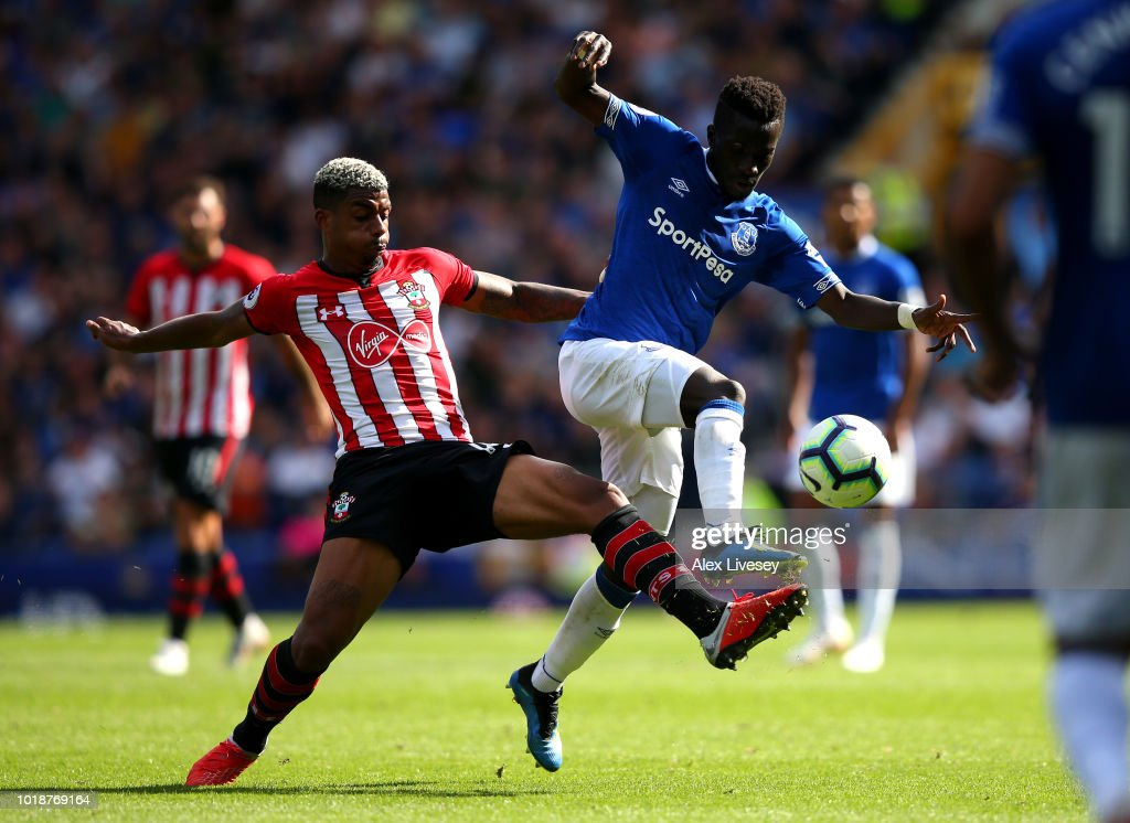 Mario Lemina of Southampton and Idrissa Gueye of Everton battle for the ball during the Premier League match between Everton FC and Southampton FC at Goodison Park on August 18, 2018 in Liverpool, United Kingdom.