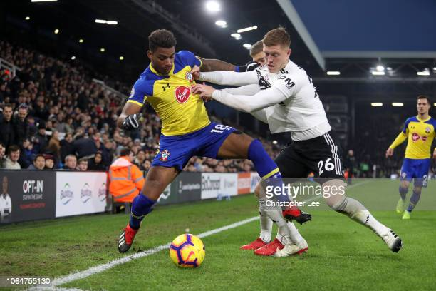 Mario Lemina of Southampton battles for possession with Alfie Mawson of Fulham during the Premier League match between Fulham FC and Southampton FC...