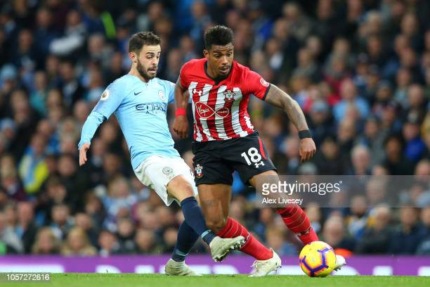 Mario Lemina of Southampton battles for possession with Bernardo Silva of Manchester City during the Premier League match between Manchester City and...