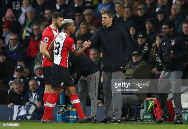 Mario Lemina of Southampton celebrates scoring with Mauricio Pellegrino manager of Southampton during the Premier League match between West Bromwich...