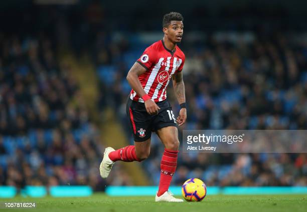 Mario Lemina of Southampton FC runs with the ball during the Premier League match between Manchester City and Southampton FC at Etihad Stadium on...