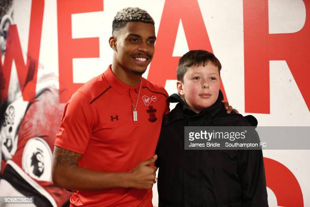 Mario Lemina of Southampton FC with a young fan taking a photo ahead of the Premier League match between Southampton and Stoke City at St Mary's...
