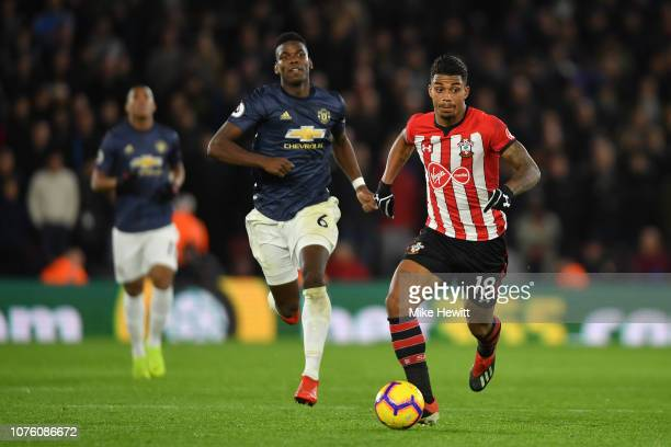 Mario Lemina of Southampton gets away from Paul Pogba of Manchester United during the Premier League match between Southampton FC and Manchester...
