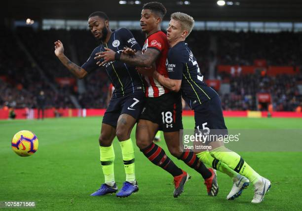 Mario Lemina of Southampton is blocked by Raheem Sterling and Oleksandr Zinchenko of Manchester City during the Premier League match between...