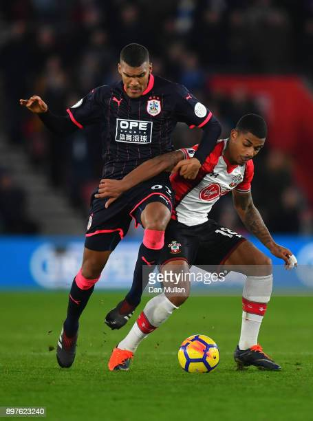Mario Lemina of Southampton is challenged by Collin Quaner of Huddersfield Town during the Premier League match between Southampton and Huddersfield...