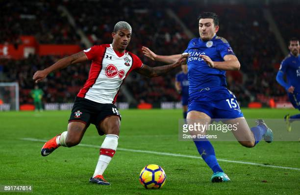 Mario Lemina of Southampton is challenged by Harry Maguire of Leicester City during the Premier League match between Southampton and Leicester City...