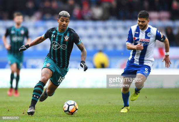 Mario Lemina of Southampton is chased by Sam Morsy of Wigan Athletic during The Emirates FA Cup Quarter Final match between Wigan Athletic and...