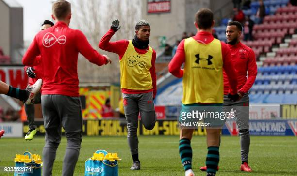 Mario Lemina of Southampton warms up ahead of the FA Cup Quarter Final match between Wigan Athletic and Southampton FC at the DW Stadium on March 18...